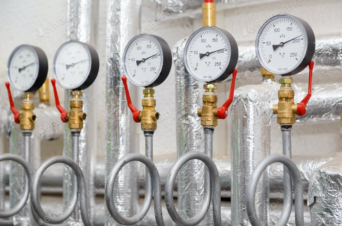 Set of manometers in industrial heating system in a boiler room