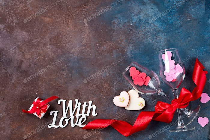 Stone background with red hearts, gifts and letters. The concept of Valentine Day