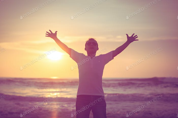 happy man standing on the beach