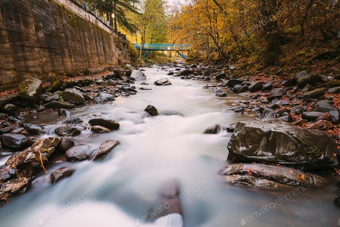 Borjomi, Georgia. Scenic View Of Autumn Borjomula Mountain River. Landscape With Long Exposure