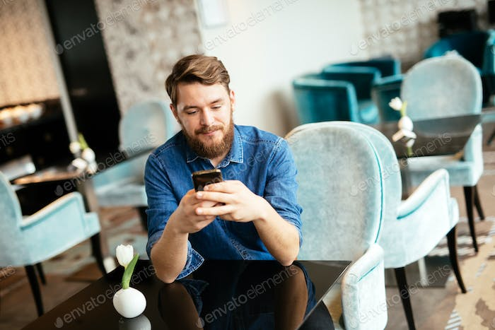 Man waiting for woman in restaurant