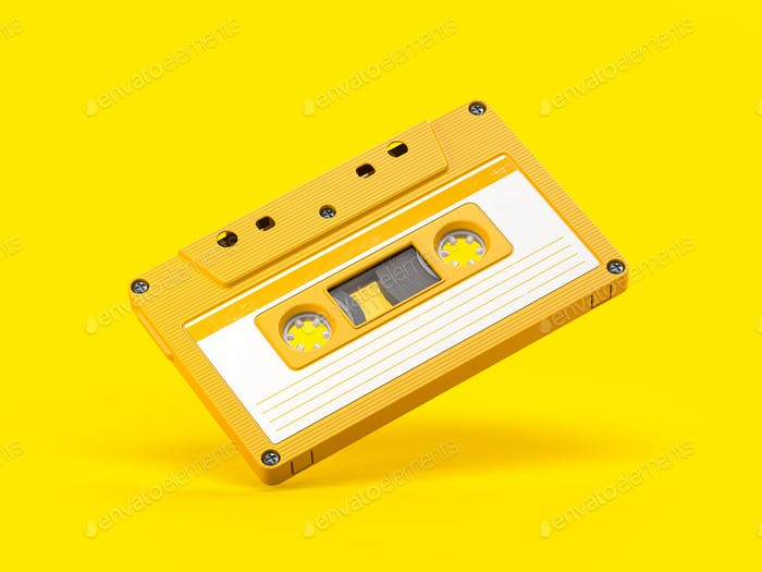 Yellow vintage audio cassette on yellow background.