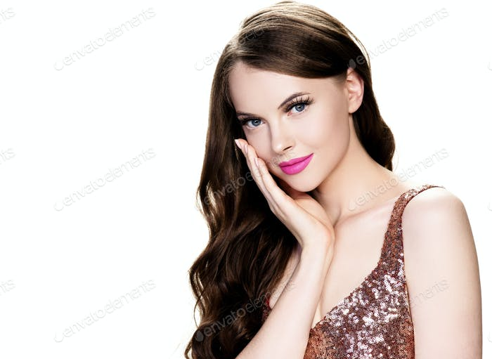 Brunette woman with long hair pink lipstick lips, female with beautiful eyes with lash extensions
