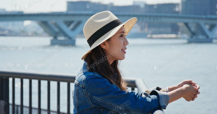 Woman looks around the harbor in Tokyo