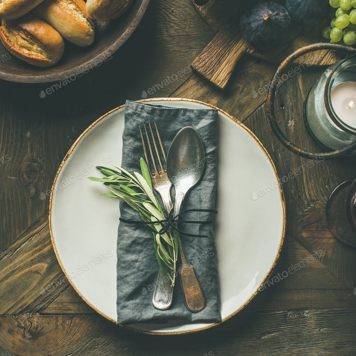 Fall table setting with cutlery and decoration, square crop