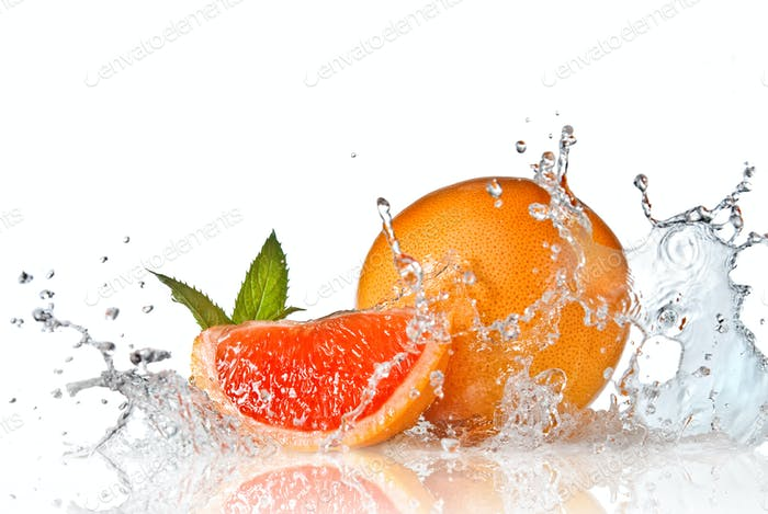 Water splash on grapefruit with mint isolated on white