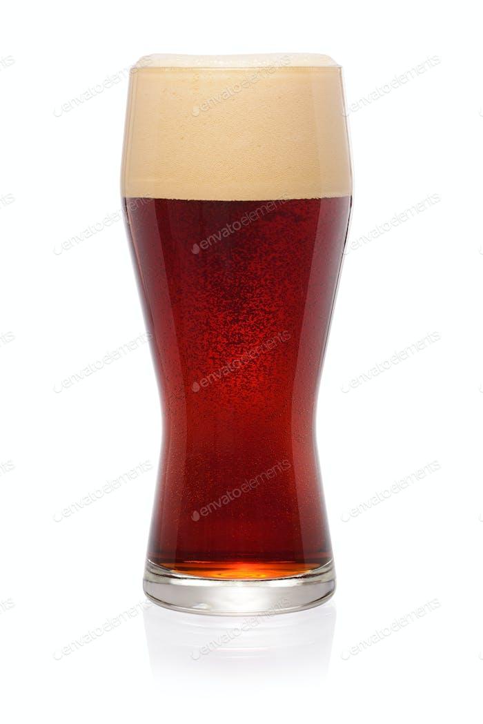 Glass of dark beer on white