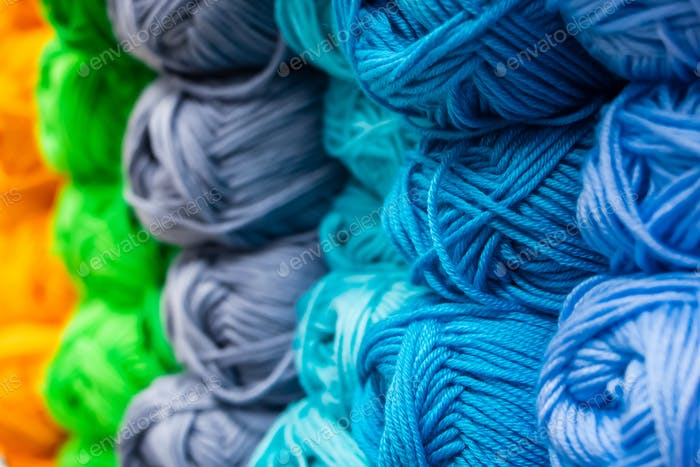 The texture of multi-colored fluffy woolen threads for knitting.