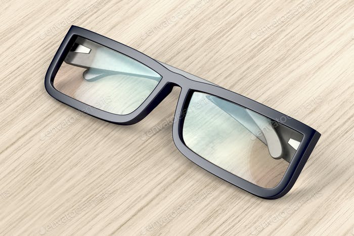 Eyeglasses on wood background