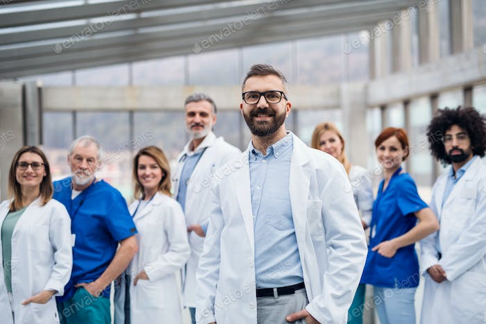Group of doctors standing in corridor on medical conference