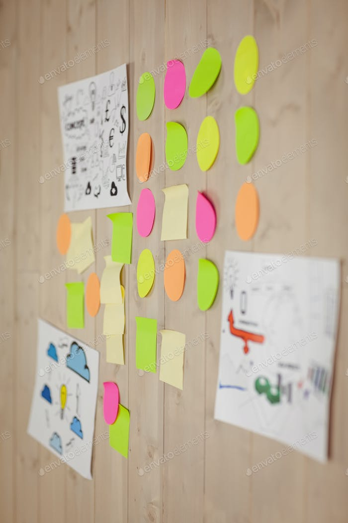 Brainstorm wall in creative office on wooden wall