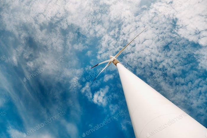 A white Windmill against a blue sky. Windmill in nature