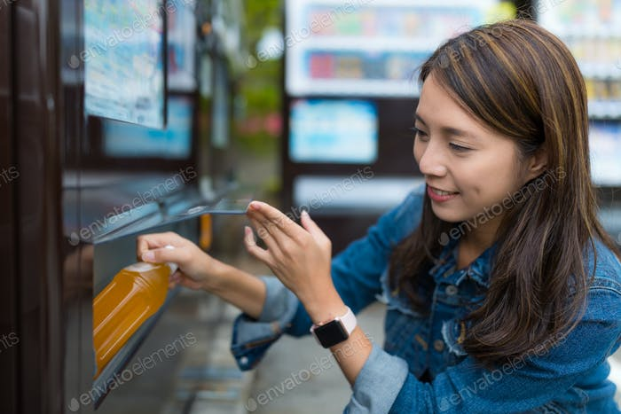 Woman buy drink in vending machine