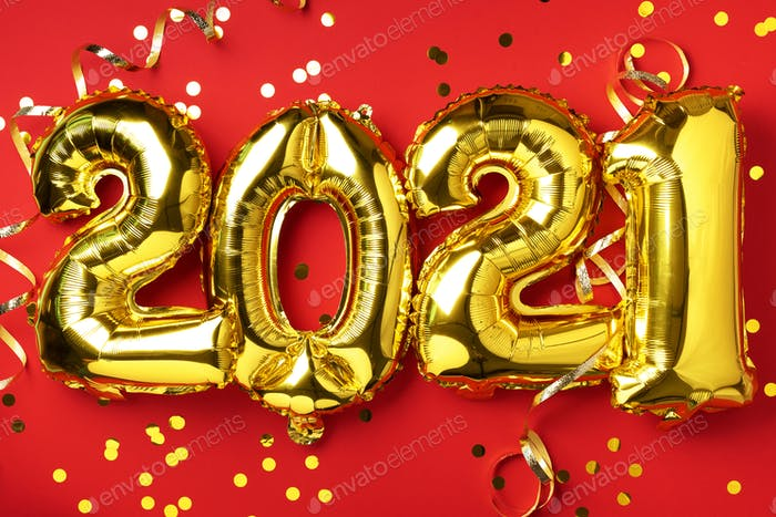 Golden foil balloons made numbers 2021 on red background with light bokehs. Happy new year