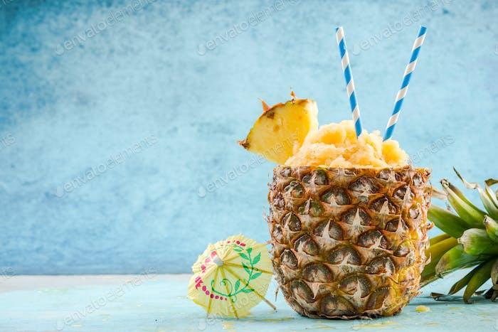 Serving tropical ice granita in pineapple