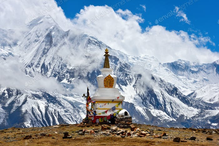 Buddhist stupa and Himalayas landscape