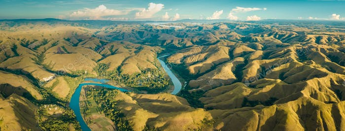 Mountain green hills panorama with curvy river