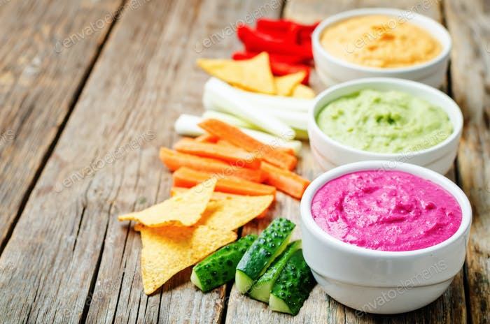 multicolored vegetables beans hummus with vegetables and chips