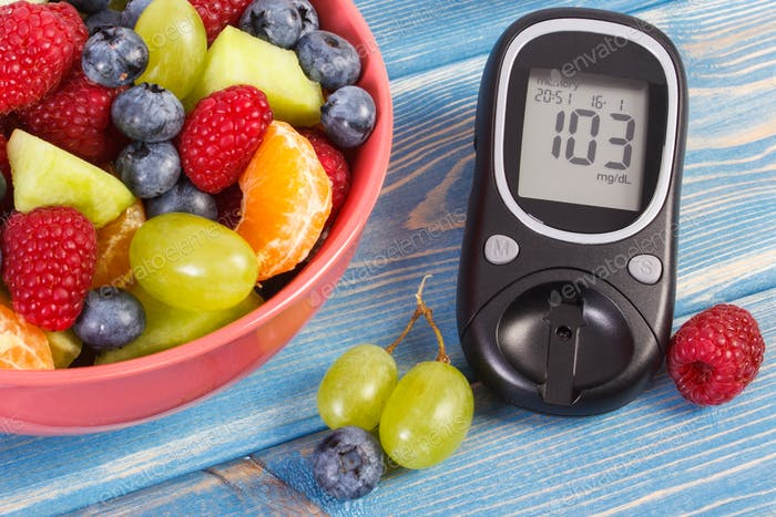 Fresh fruit salad and glucose meter, diabetes, healthy lifestyle and nutrition concept