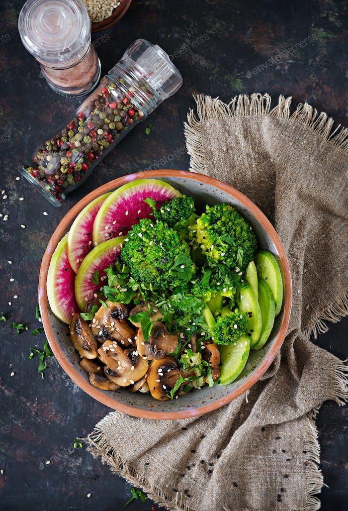 Healthy vegan lunch bowl. Grilled mushrooms, broccoli, radish salad.