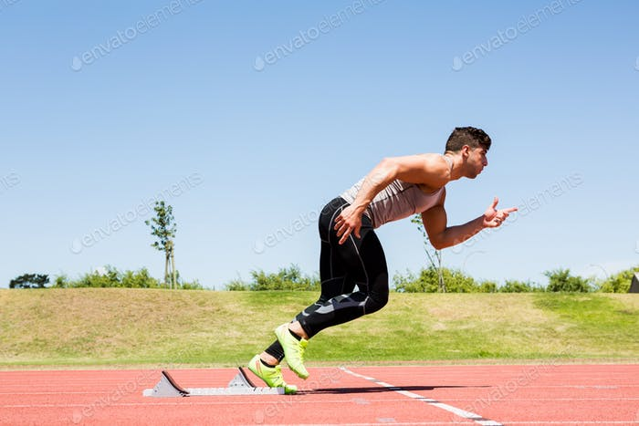 Athlete running on the running track