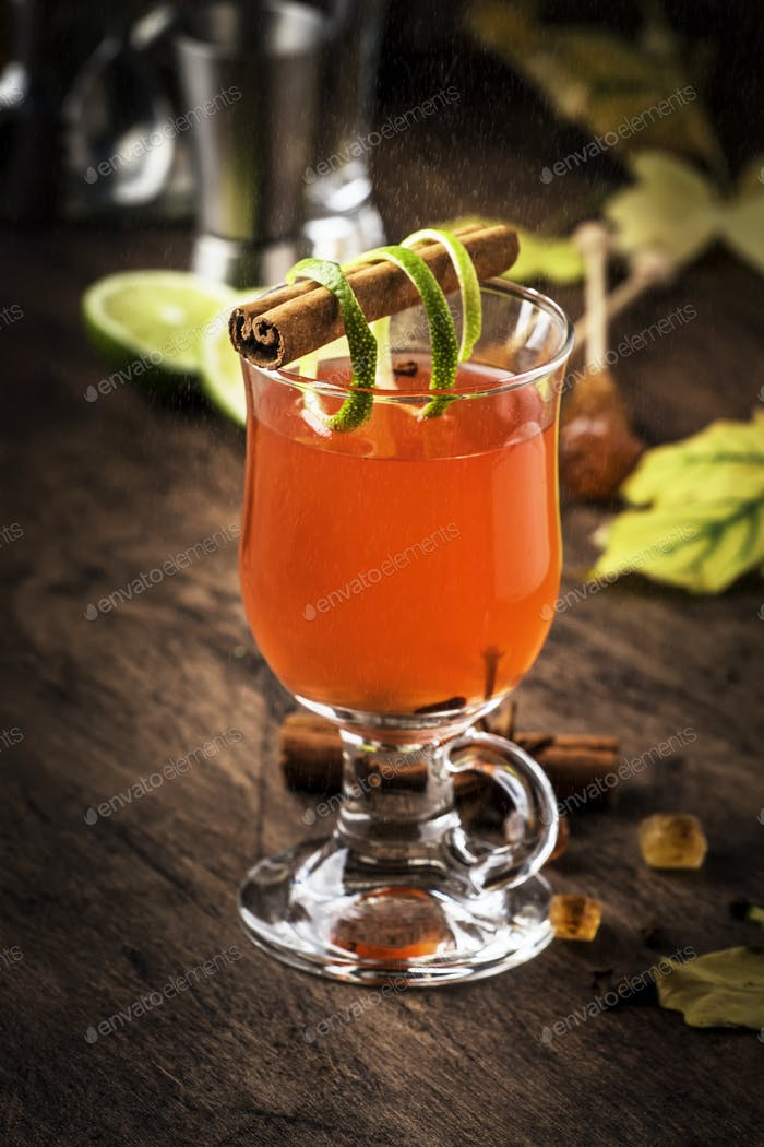 Hot rum punch, autumn or winter warming alcoholic cocktail