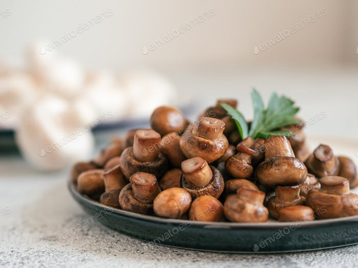 Fried mini champignons on plate, copy space