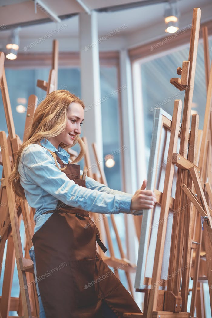 Attractive young woman with easels