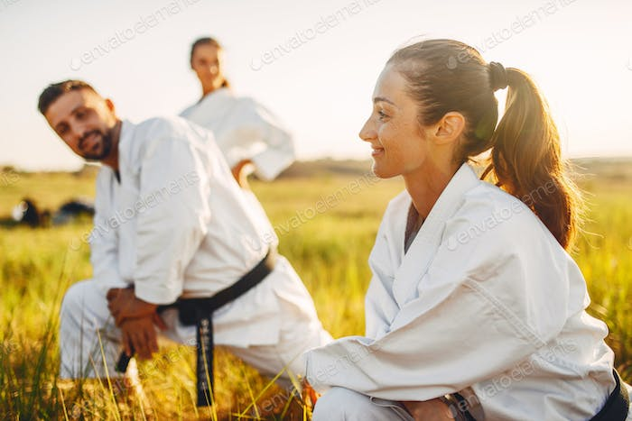 Two female karate with male instructor on training