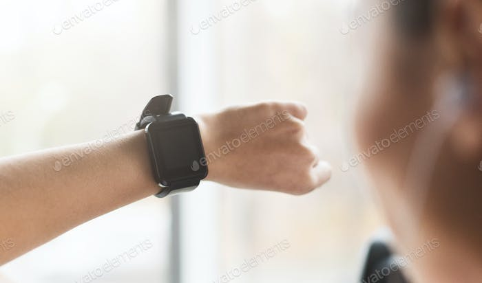 Girl using sport smart watch, doing cardio exercise