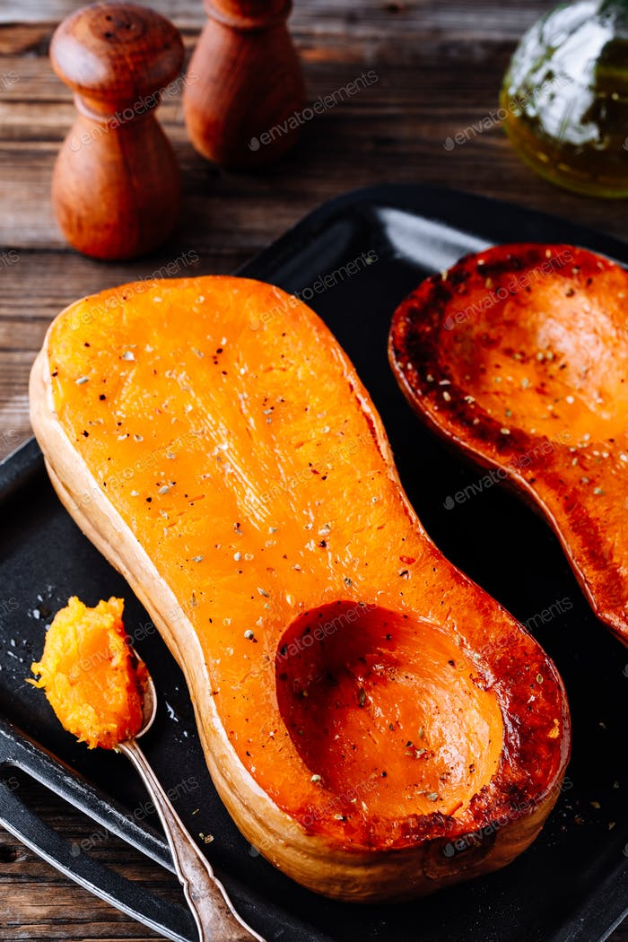 Baked butternut squash pumpkin, ingredient for a warm fall soup.