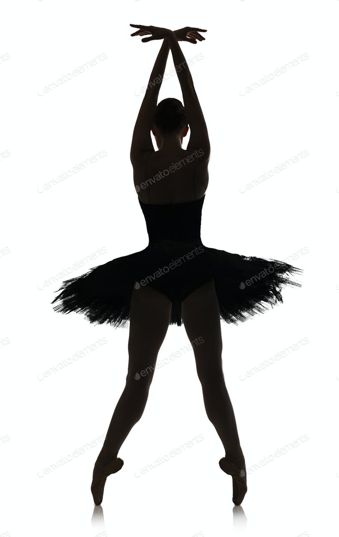Ballerina silhouette making ballet position against white background, isolated
