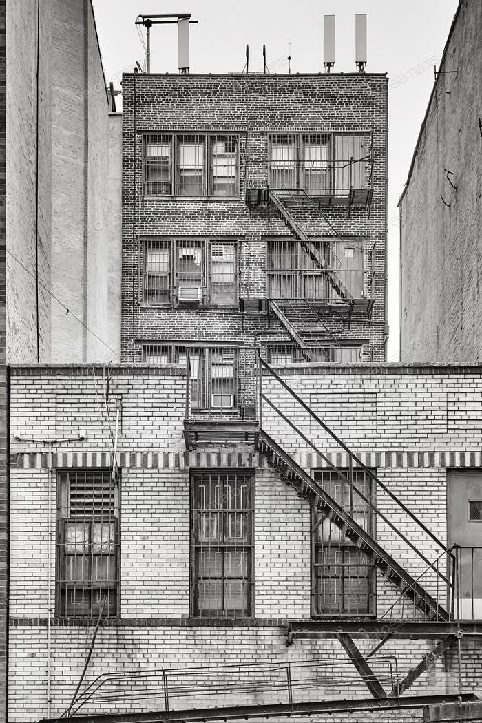 Old brick building with fire escapes, New York City.