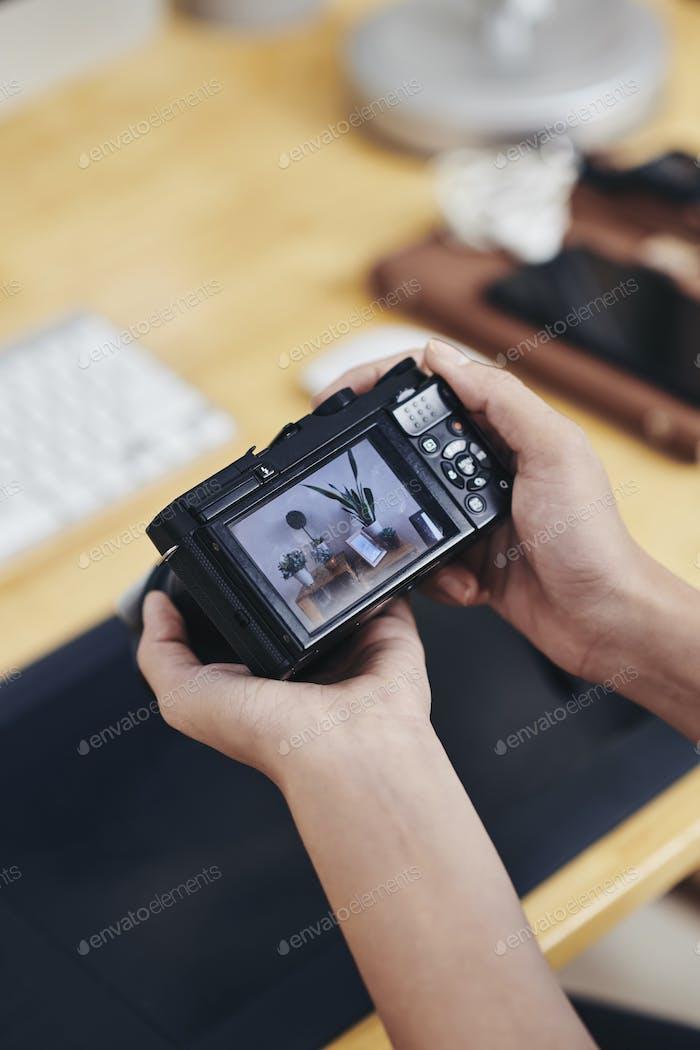Photographer checking digital camera