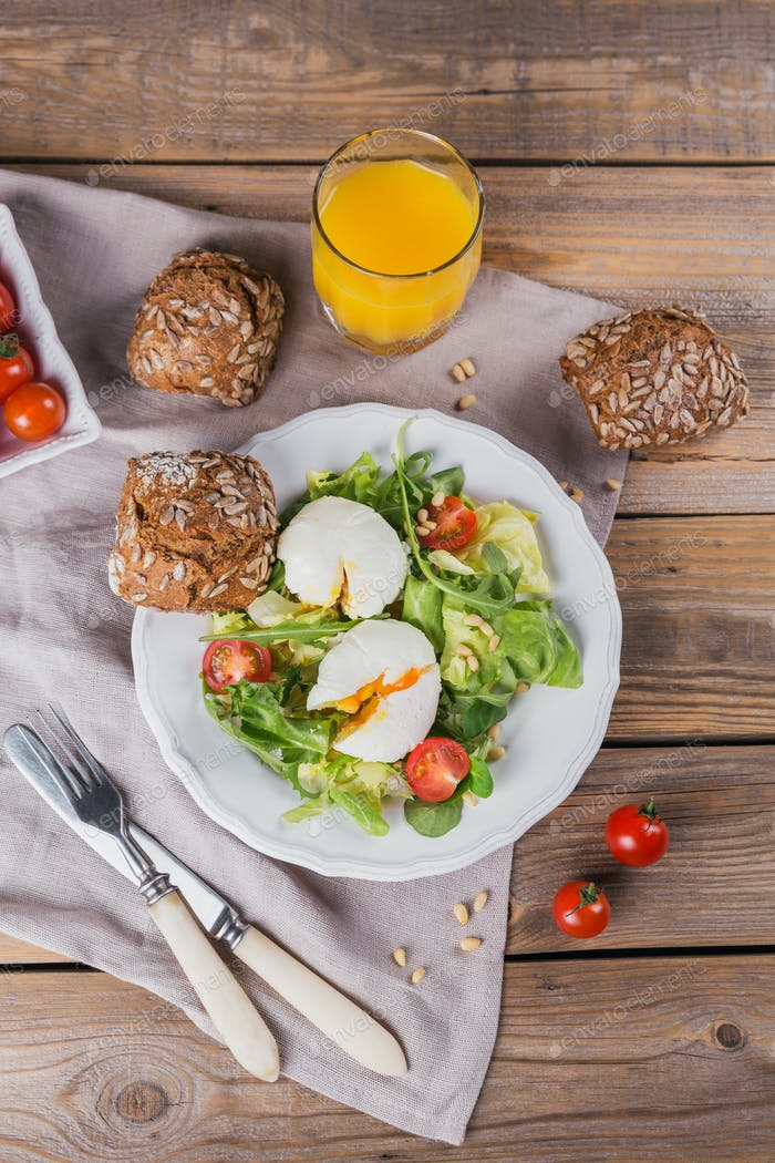 Healthy Breakfast with Poached Egg, Green Salad, Tomatoes and Wholemeal Bread
