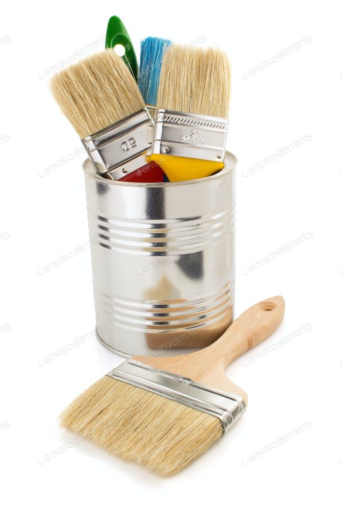 paint bucket and paintbrush on white