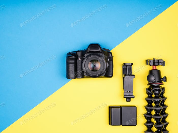 Flat lay top view of camera with accessories