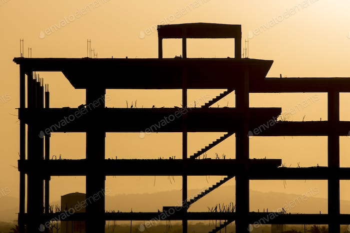 Silhouette of construction with orange sunset in Venzuela