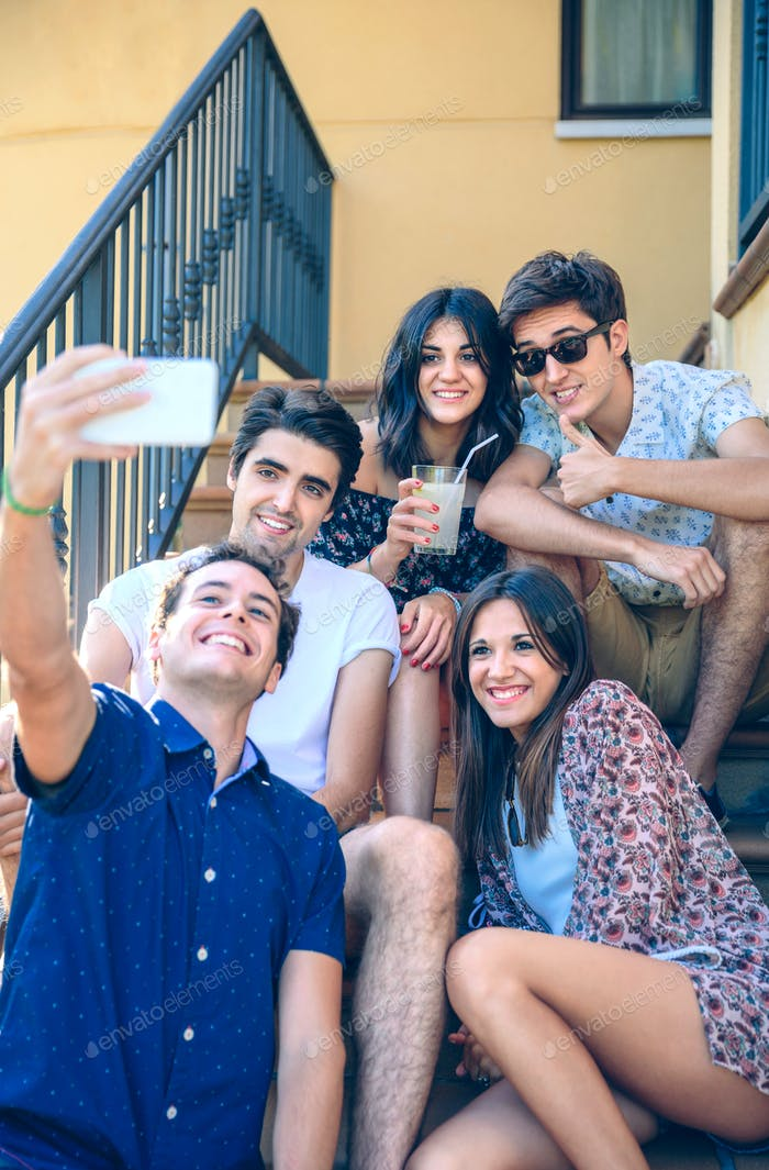 Young happy people taking a selfie with smartphone