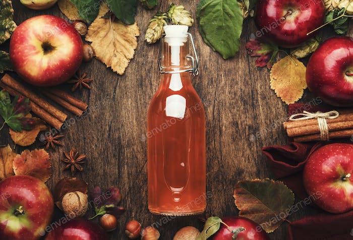 Apple cider vinegar. Bottle of fresh apple organic vinegar on wooden table