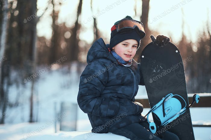 Portrait of a boy at winter forest