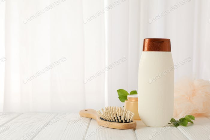 Composition with body care products on wood table