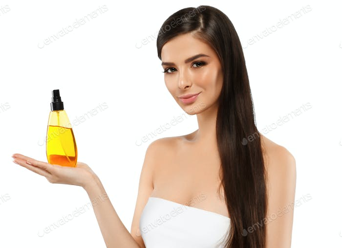 Woman with oil cosmetic beauty skin care concept. Young female model spa with oil skincare