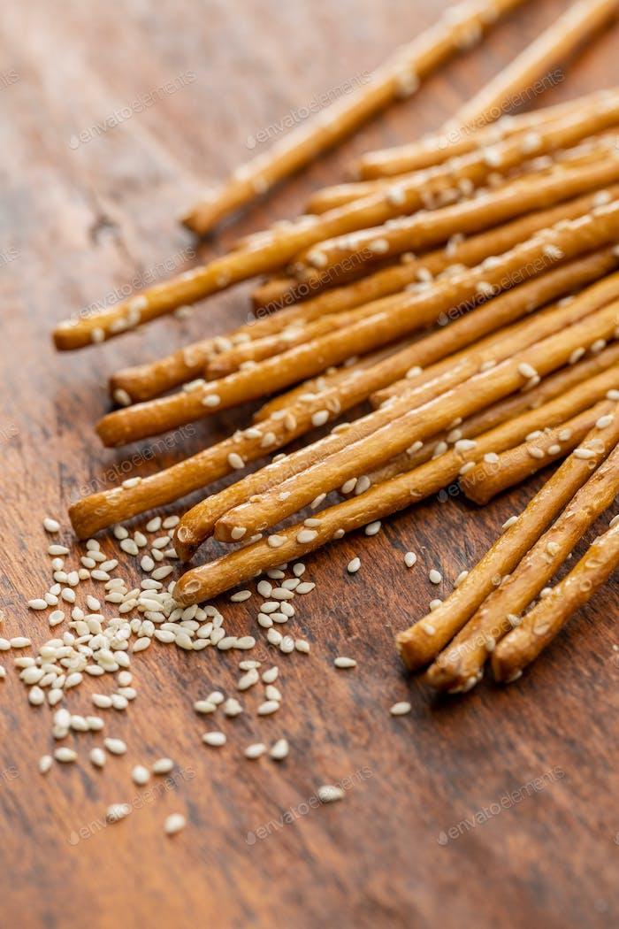 Salty sticks. Crunchy pretzels with sesame seeds