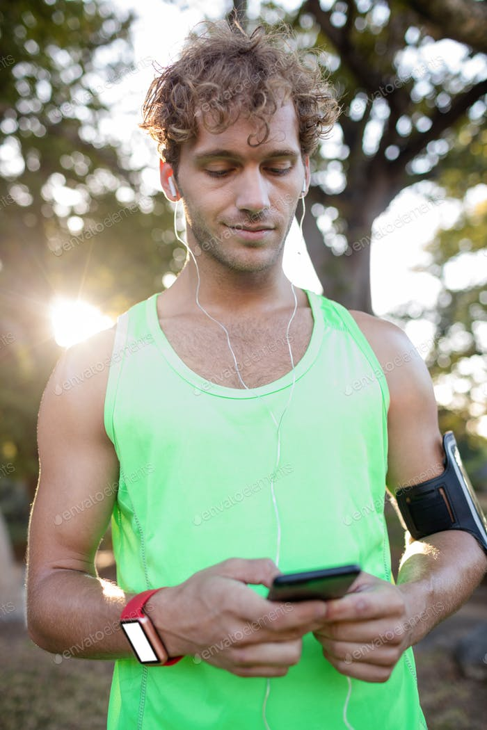 Smiling jogger listening to music