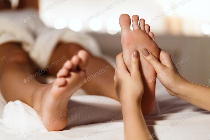 Woman Having Foot Massage, Relaxing In Spa Salon