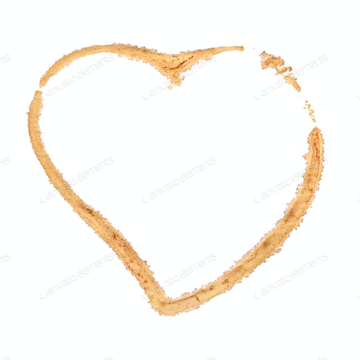 Brown coffee cup stain heart shape isolated.