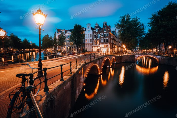 Night cityview of Famous Keizersgracht Emperor's canal in Amsterdam, tranquil scene with street