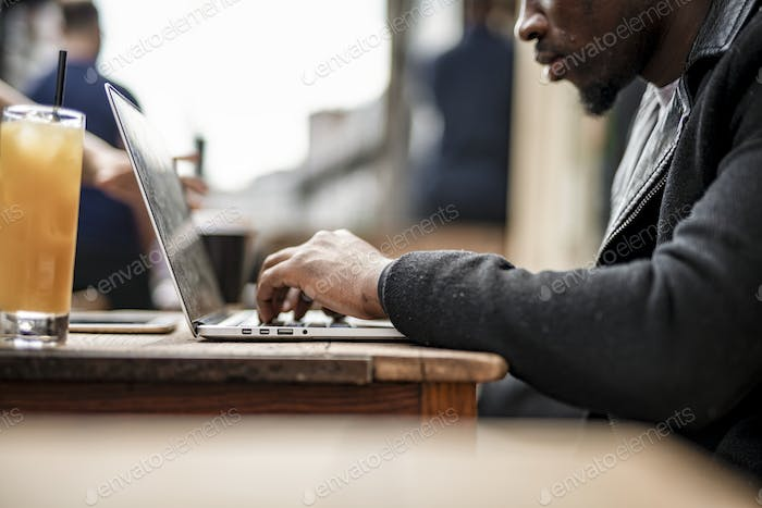 Businessman working remotely from a cafe