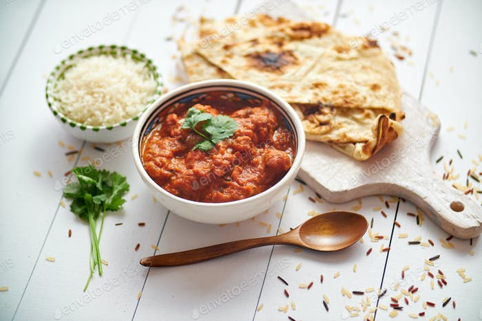 Fresh and tasty Chicken tikka masala served in ceramic bowl